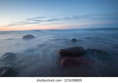 Beautiful sunset over the baltic sea photograped with long esposure