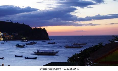 beautiful sunset over bay at Sabang, Puerto Galera, Oriental Mindoro, Philippines