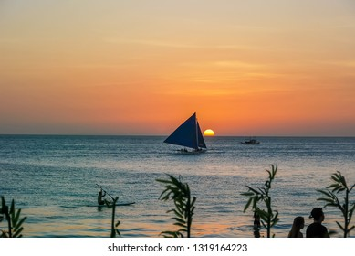 Beautiful sunset over bay at Sabang Puerto Galera of Oriental Mindoro, Philippines March 2017. Yacht sailing against sunset. Yachting tourism maritime evening walk. Romantic trip during sea sunset.