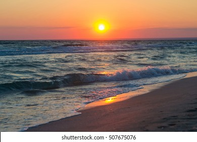 Beautiful sunset over the Black Sea in the summer. Sea landscape. Nature composition