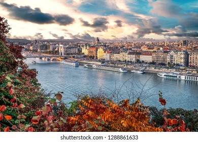 Beautiful sunset over the capital city of Hungary, Budapest. Aerial view with the Danube river, Chain Bridge and the Parliament building in autumn.