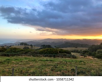 Beautiful Sunset over Coastal Country fields and rolling hills