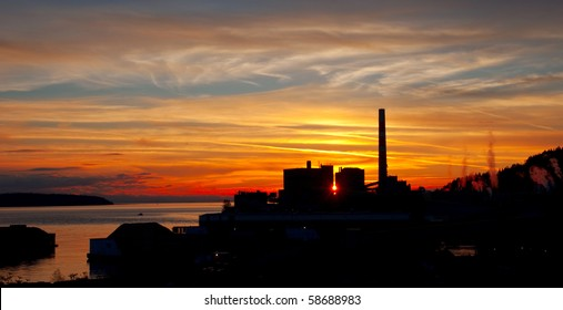 Beautiful sunset over a coastal lumber mill.