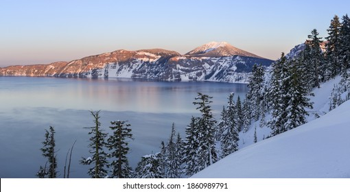 Beautiful sunset over Crater Lake in frost winter day. Crater Lake National Park, Oregon, USA