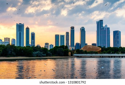 Beautiful sunset over emirate of Sharjah skyline in the Uinted Arab Emirates