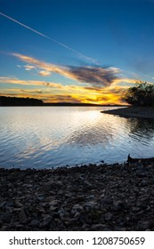 Beautiful sunset over fellows lake in Springfield Missouri, Verticle