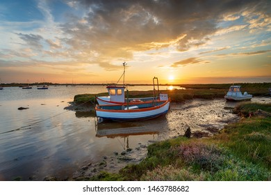 Beautiful sunset over fishing boats on the River Alde at Aldeburgh on the Suffolk coastline