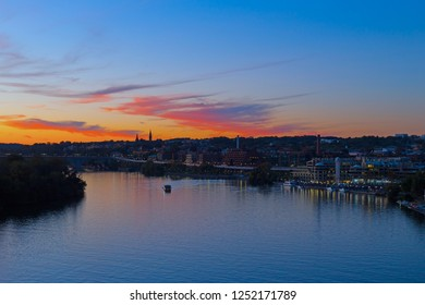 Beautiful sunset over Georgetown waterfront, Washington DC, USA. US capital panorama near Potomac River.
