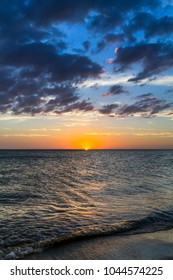 A beautiful sunset over the Gulf of Mexico is viewed from the beach at Treasure Island, Florida.