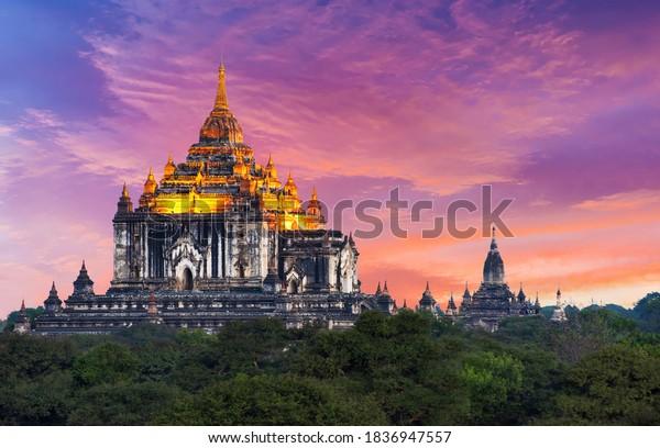 Beautiful sunset over illuminated old pagoda Thatbyinnyu Phaya in the ancient city of Bagan, Myanmar