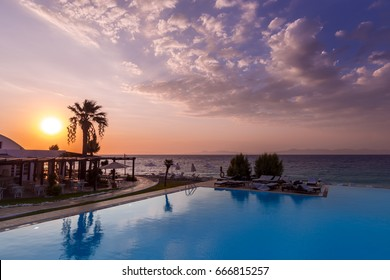 Beautiful sunset over an infinit pool and the Mediteraneean Sea in the Ixia gulf, on the western coast of the Rhodos island, near the Rhodos city