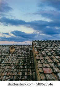 Beautiful sunset over an Italian, Tuscan, rooftop. Pretty blue and pink sky and soft clouds. Stigliano, Tuscany, Italy, Europe.