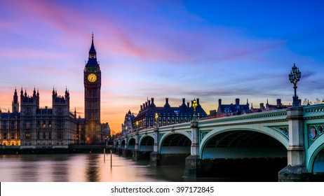 Beautiful sunset over the London skyline, overview of The House of Parliament and Westminster Bridge form Southbank of the Thames River. London, United Kingdom.
