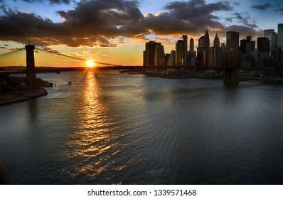 Beautiful sunset over a Manhattan with Brooklyn Bridge.