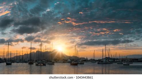 Beautiful sunset over Monte Cara mountain in hardor of Mindelo. Sao Vicente Cape Verde