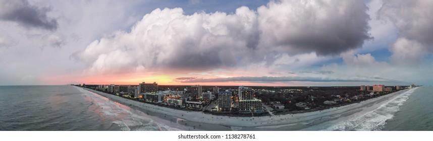 Beautiful sunset over Myrtle Beach coastline, aerial view.