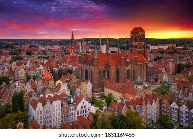 Beautiful sunset over the old town of Gdansk with City Hall and St. Mary Basilica, Poland