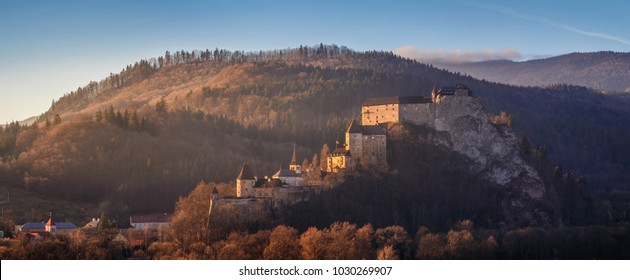 Beautiful sunset over Orava Castle - is situated on a high rock above Orava river, Slovakia.