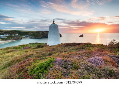 Beautiful sunset over the Pepperpot lighthouse at Portreath in a carpet of late summer heather