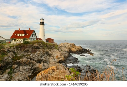 Beautiful sunset over the Portland Head Light Lighthouse at Fort Williams Park , Portland, Maine, USA. Portland Head Light is located at Cape Elizabeth.