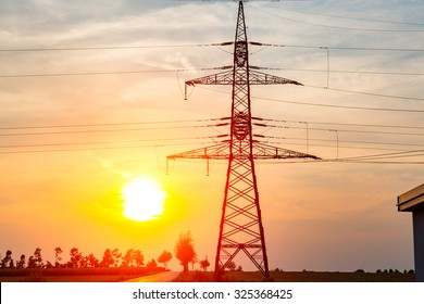 Beautiful sunset over the powerlines on the field