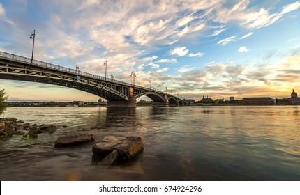 Beautiful sunset over Rhine / Rhein river and old bridge in Mainz near Frankfurt am Main, Germany.