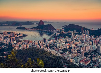 Beautiful sunset over Rio De Janeiro Botafogo Bay in Brazil. Warm sky above the ocean