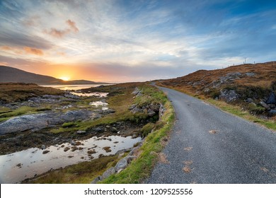 Beautiful sunset over the road that leads to Luskentyre on the Isle of Harris in Scotland