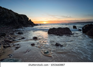 Beautiful sunset over the rocks on Freshwater West beach in the Pembrokeshire Coast National Park in Wales