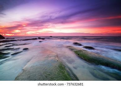 Beautiful sunset over a rocky beach in Sabah Malaysia