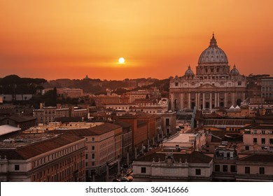 Beautiful sunset over Rome, Italy; St. Peter's Basilica on background.