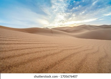 Beautiful sunset over sand dunes of Sahara Desert, Morocco, Africa
