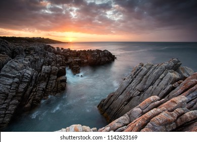 Beautiful sunset over the sandstone cliffs along the coastline of De Kelders in Gansbaai in the Overberg of south africa