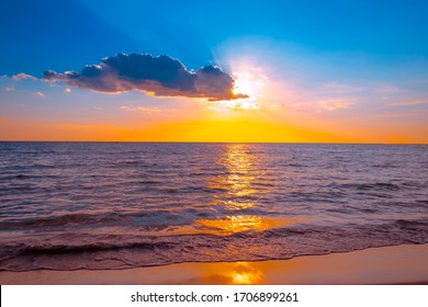 Beautiful sunset over the sea on the tropical beach with Orange color sky and clouds for travel in holiday relax time