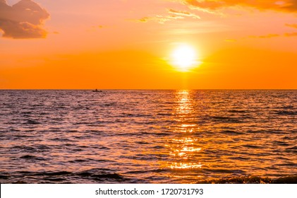 Beautiful sunset over the sea on the tropical beach with sky and clouds for travel in holiday relax time