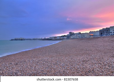 Beautiful sunset over the sea and pier seen from the beach at Worthing, West Sussex - England