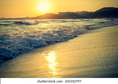 Beautiful sunset over sea with reflection in water. Scenic panoramic view of beach at Avsalar, Alania, Turkey, Mediterranean sea. Copy space.