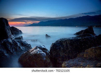 Beautiful sunset over the sea and rocky shore