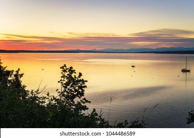 Beautiful Sunset Over the Sea. Two Anchored Sailing Boats are Visible on the Left Side of The Picture. Chamainus, Vancouver Island, BC, Canada.