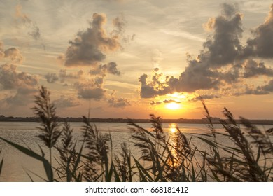 Beautiful sunset over a smooth lake water surface