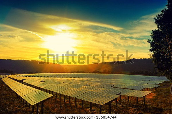 Beautiful sunset over solar energy field