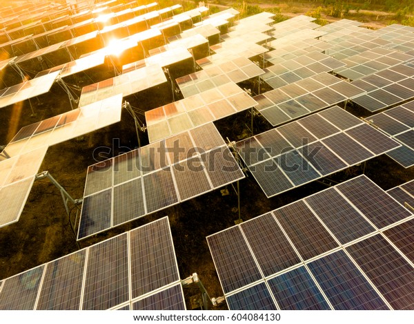 Beautiful sunset over Solar Farm with sunset on the background