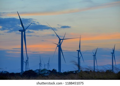 Beautiful sunset over some wind turbines in the grasslands of Panama