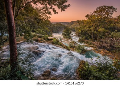 Beautiful sunset over the turquoise waterfalls at Agua Azul in Chiapas, Mexico