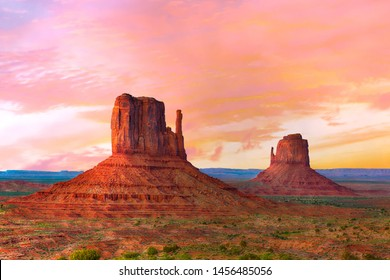 Beautiful sunset over the West and East Mitten Butte in Monument Valley. Utah, USA