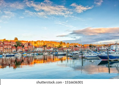 Beautiful Sunset over Whitby Harbour with boats and yachts , North Yorkshire Coast, England,August 24th 2018