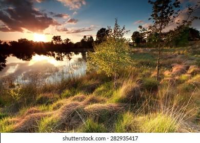 beautiful sunset over wild lake, North Brabant, Netherlands