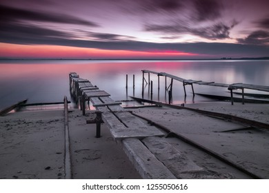 Beautiful sunset over the wooden piers on the beach