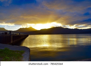 Beautiful sunset overlooking Kaneohe Bay at a pier. On the island of Oahu, Hawaii