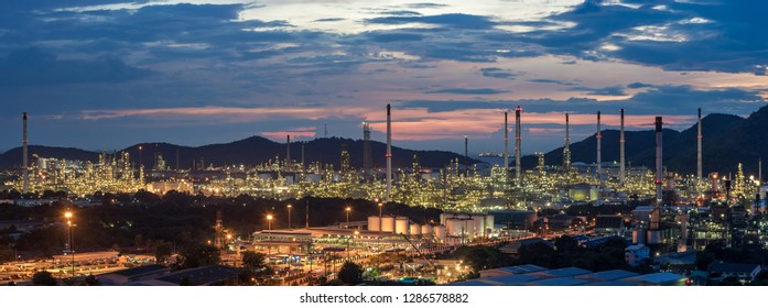 Beautiful sunset panoramic petrochemical oil refinery factory plant cityscape of Chonburi province at night  , panorama landscape Thailand